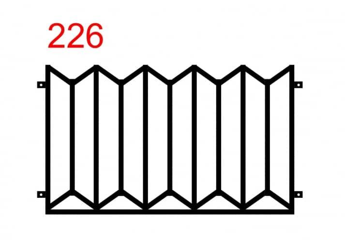 Metallzaun mit einem Muster, das übereinanderliegenden Trapezen ähnelt
